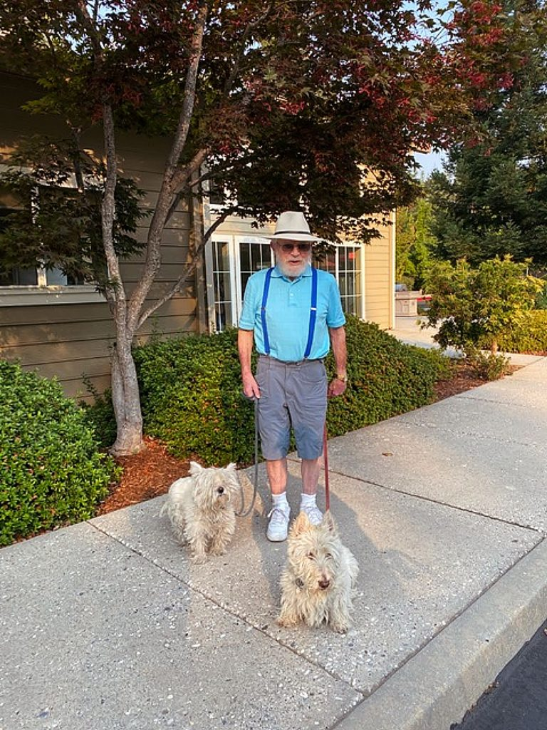 Vaughn Wright, with Sasha and Scottie, out for a morning walk under blue skies in Eskaton Village.