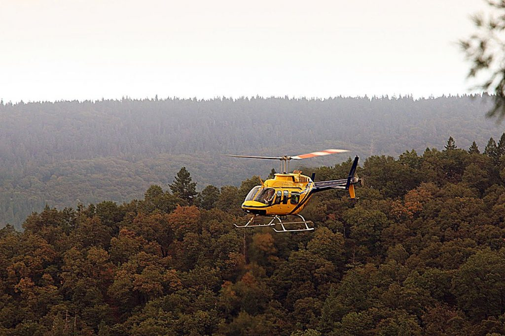 PG&E helicopter inspects power lines north of Harmony Ridge as it prepares to restore service following PSPS outage.