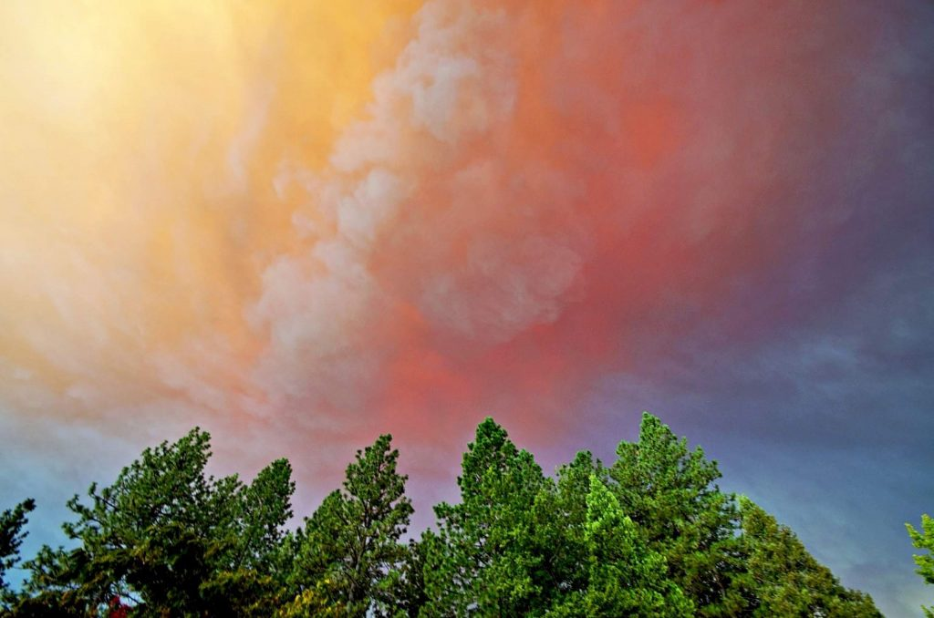 A mix of clouds and smoke, lite by a lowering sun (3:54 p.m. Sept. 8) and clouds below with weird effects.