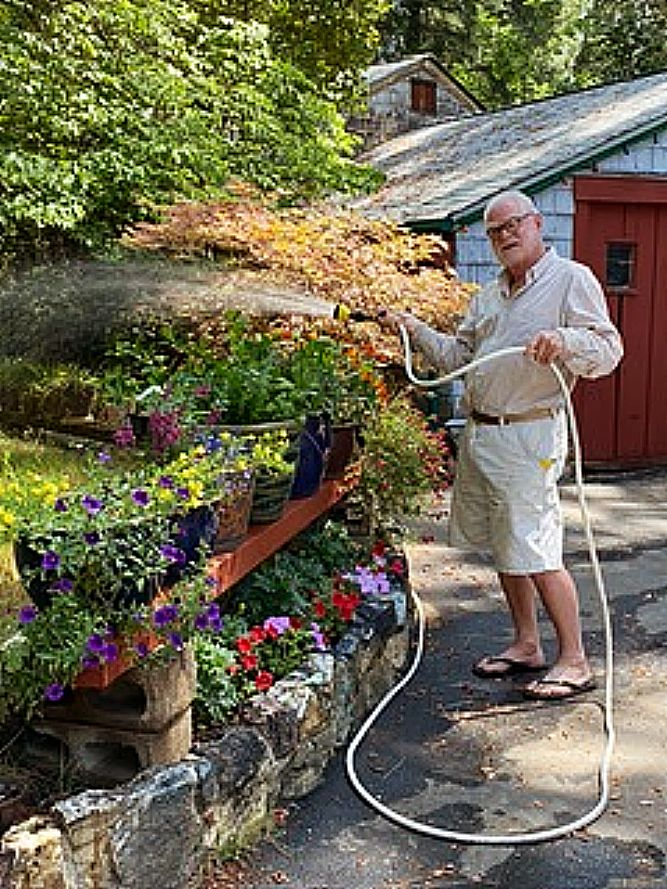 Mike caring for beautiful flowers.