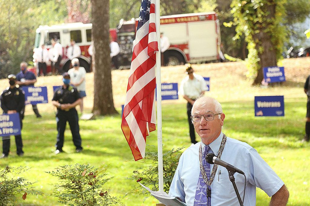 Chaplain Norris Burkes U.S.A.F. Ret. gives the closing prayer during Monday's Remembrance Day ceremony held at Memorial Park.