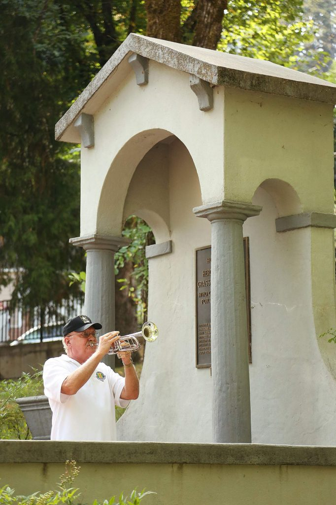 """U.S .Army Vietnam veteran Ralph Remick plays taps on the trumpet towards the end of Saturday's """"Angels Among Us"""" Remembrance Day memorial at Memorial Park."""