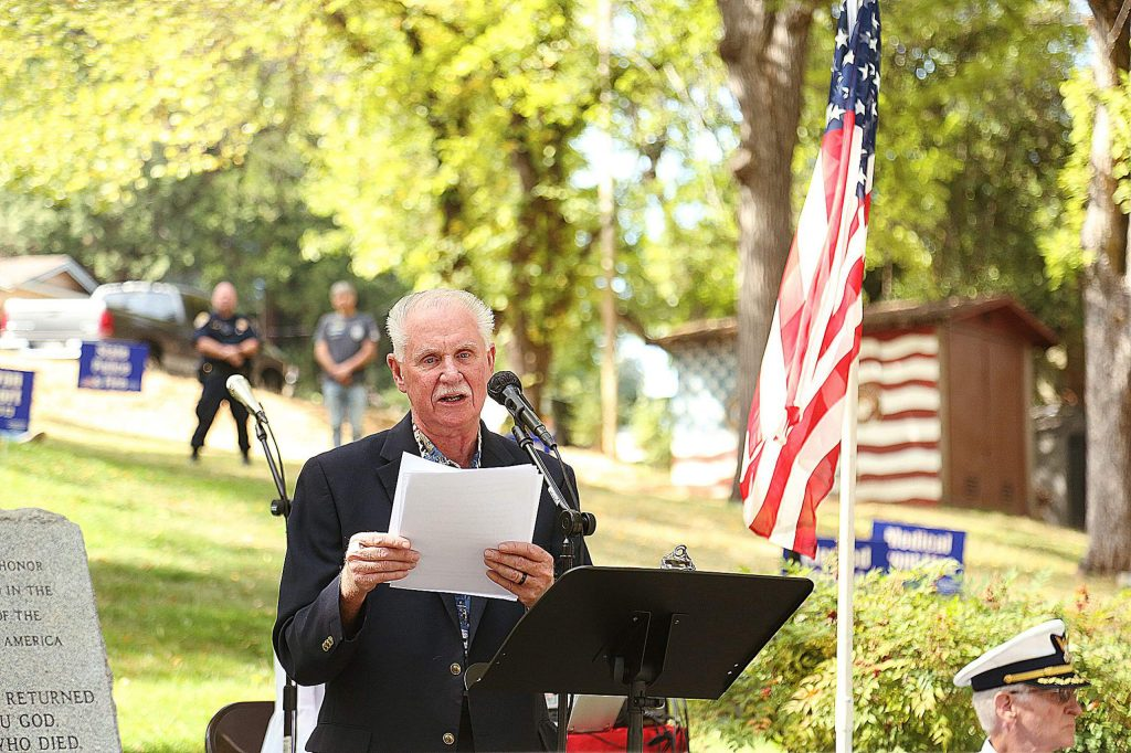 Veteran Jay Cooper gives a few words before the reading of deceased veterans names lost during Covid.