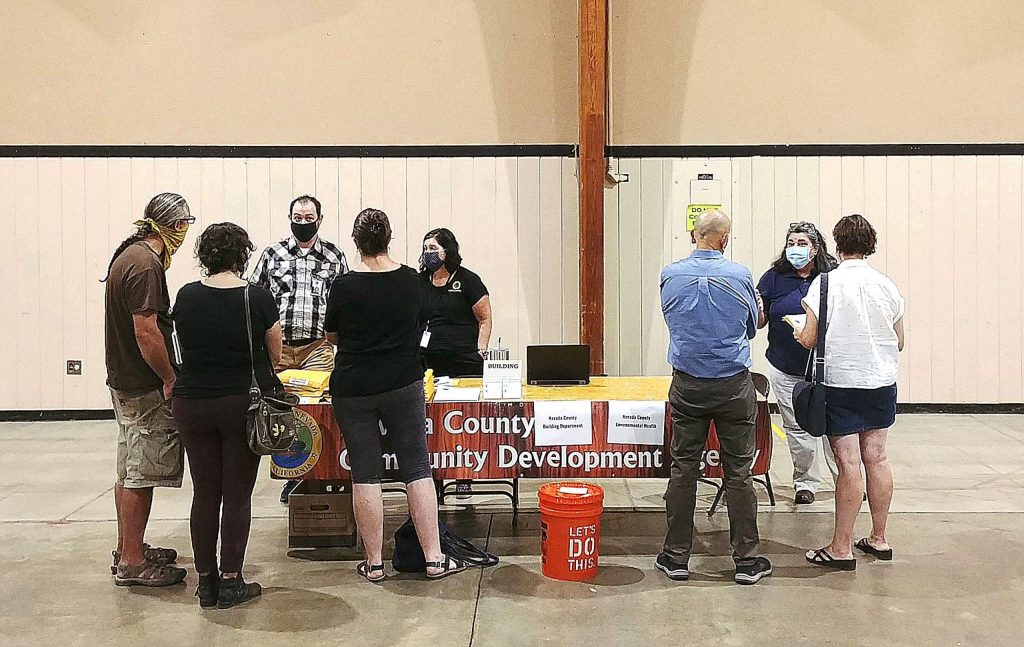 Community members affected by the Jones Fire talk to representatives from the Nevada County Community Development Agency.