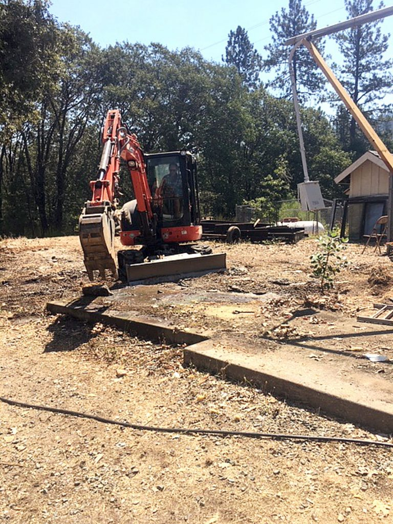 The last remnants of the modular library building are scooped away on the San Juan Ridge. A foundation for a new, permanent library structure is set to be poured soon.