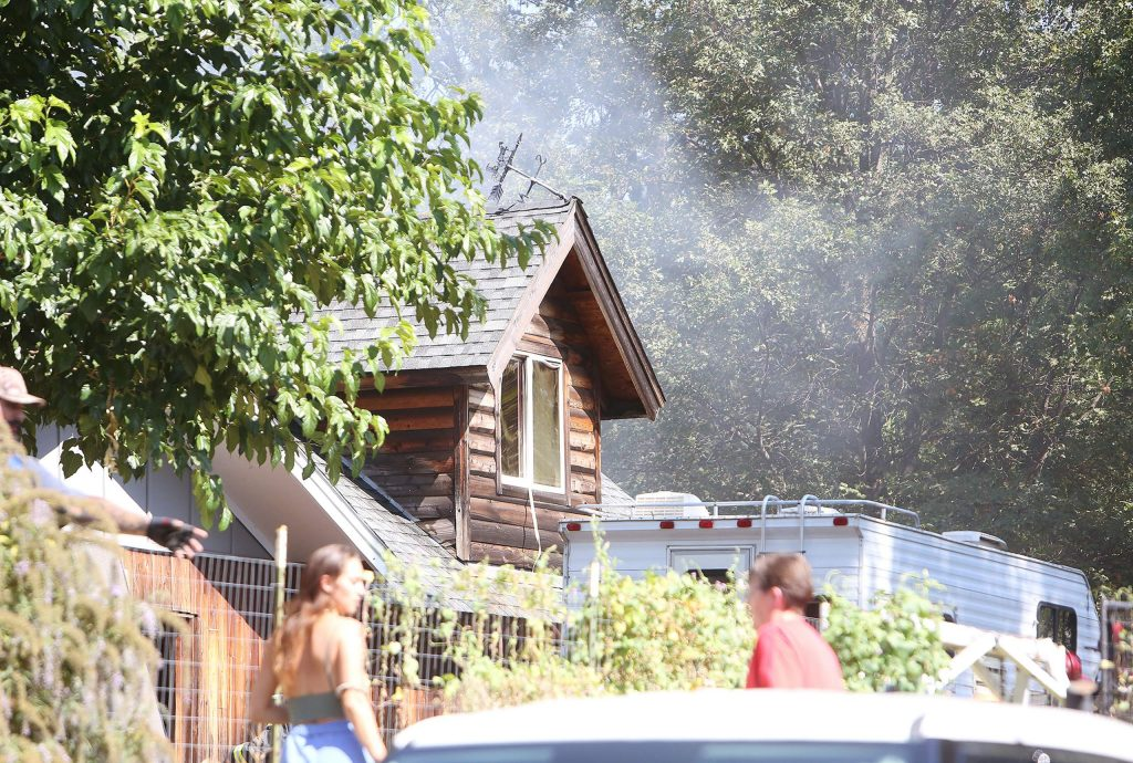 Smoke from a residential structure fire in the 100 block of Marshall Street in Grass Valley fills the neighborhood around 2:40 p.m Tuesday. Nearby trees were on fire before firefighters got them out.
