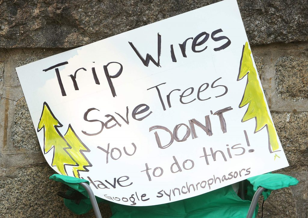 A protesters sign suggests PG&E should invest in synchrophasors Tuesday near Broad and Bennett Streets.