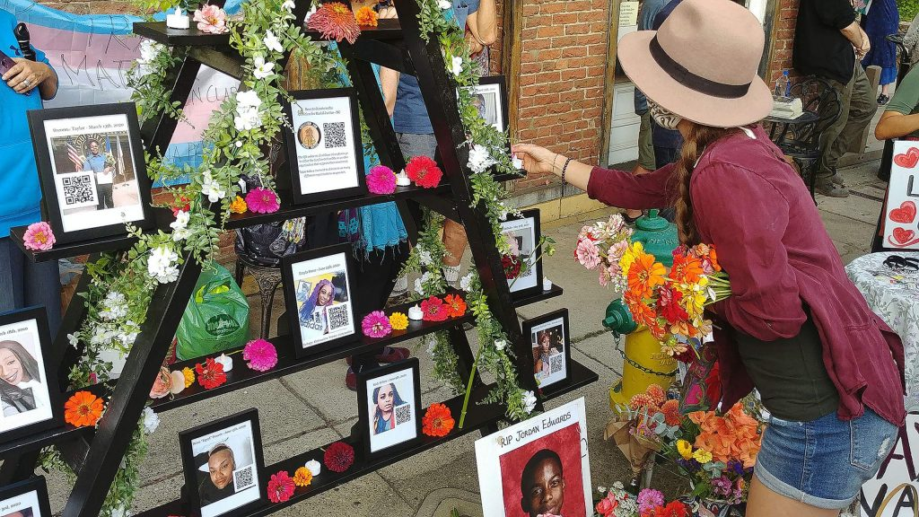 Vigil attendees pay respects to an altar set up to honor black and trans lives lost at Saturday's vigil in Nevada City.