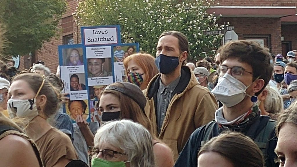 Faces in the crowd all don their face coverings while making themselves present during Saturday night's vigil to honor black lives lost in Nevada City.