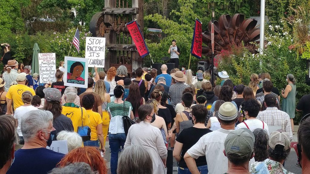 Speakers lead the crowd of hundreds through Saturday evening's vigil to honor black lives lost in downtown Nevada City.