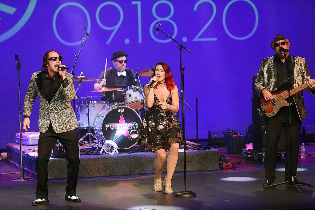 Members of the band Pop Rocks get down during the live stream of Saturday's Center for the Arts Virtual Gala 2020.