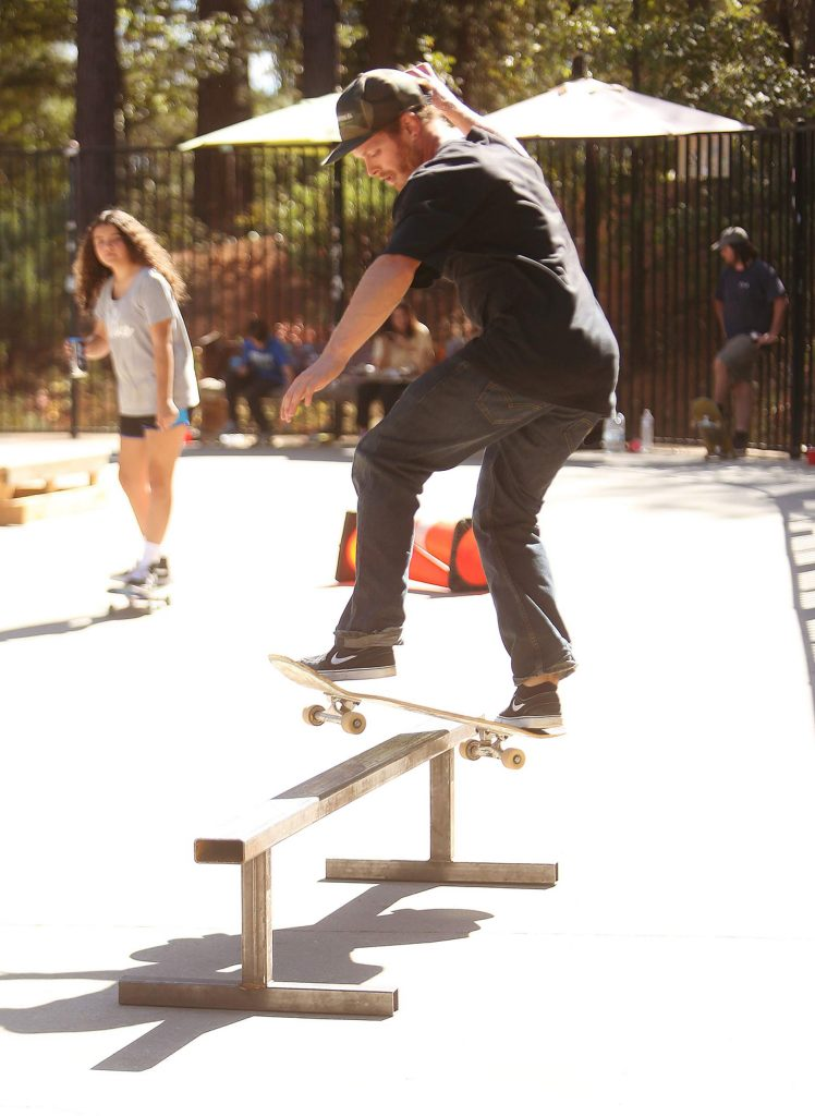 A skateboarder does a board slide on a rail at Condon Park Friday afternoon.