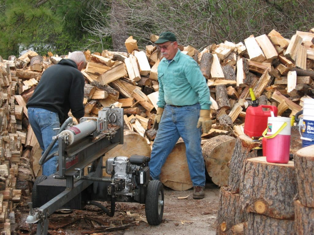 Volunteers work hard to split, stack, and deliver firewood to vulnerable seniors.  Photo courtesy of Gold Country Senior Services