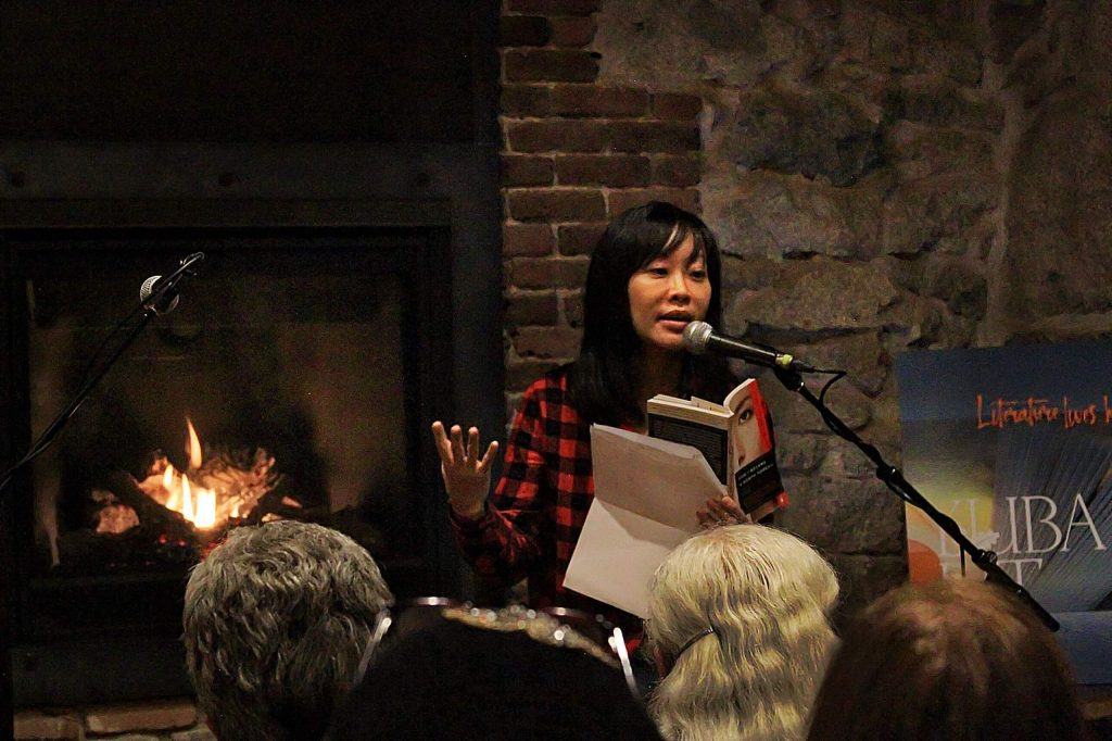 Krys Lee reading at the Stonehouse during a past Yuba Lit event.