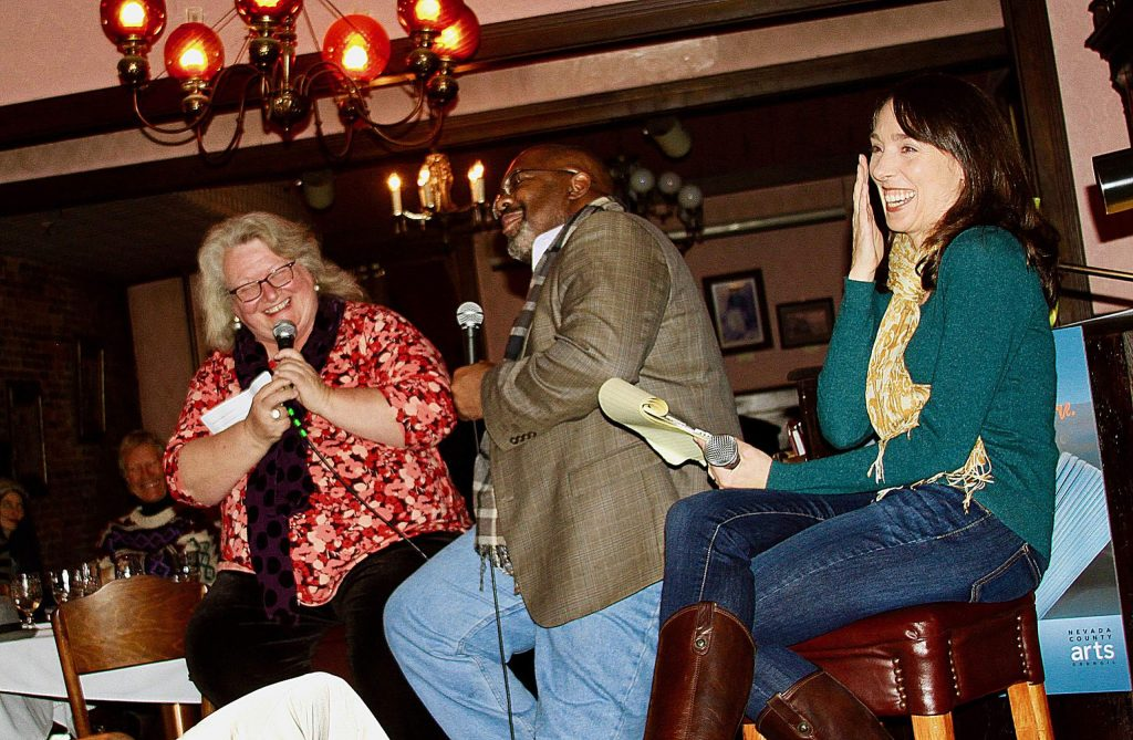 Molly Fisk, Indigo Moor and Rachel Howard laughing during a Q&A session with the audience at a past Yuba Lit event held at the National Hotel.