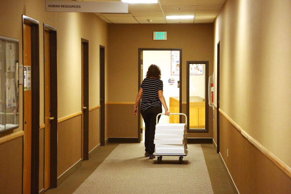 Ballots from the 2000 election are rolled down the hall from the elections office, to be placed in storage as they are scheduled to be destroyed.