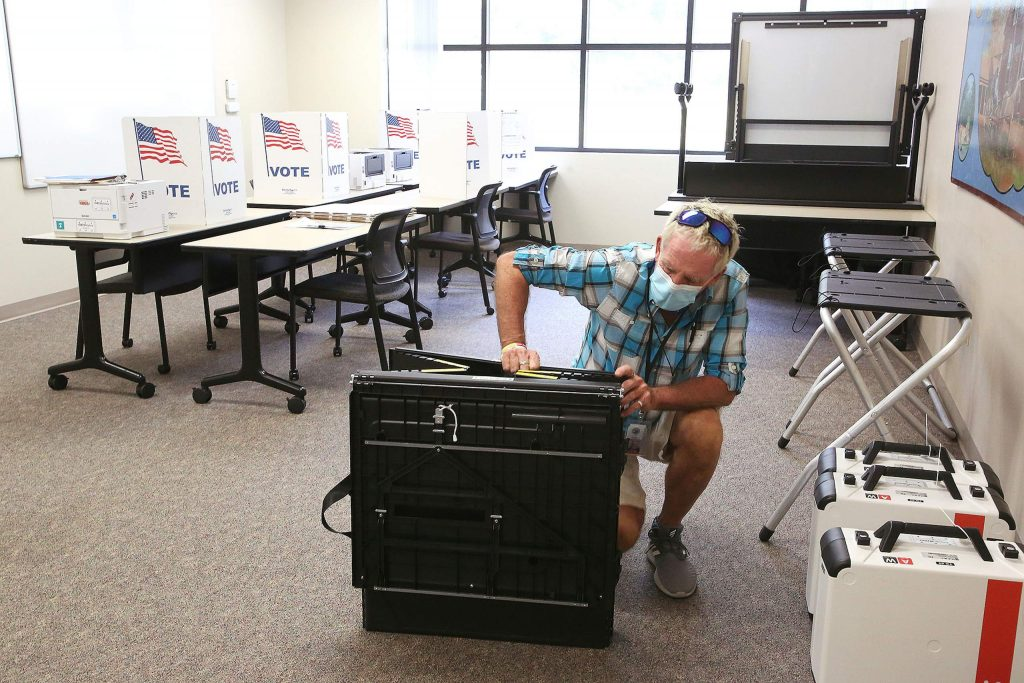 Nevada County Warehouse Manager Jim Eckardt works on setting up the early voting station Friday at the Eric Rood Administrative Center in Nevada City.