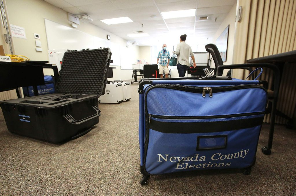 Bags and cases of official Nevada County elections materials are unpacked and their contents installed in preparation for the upcoming election and vote opportunities.