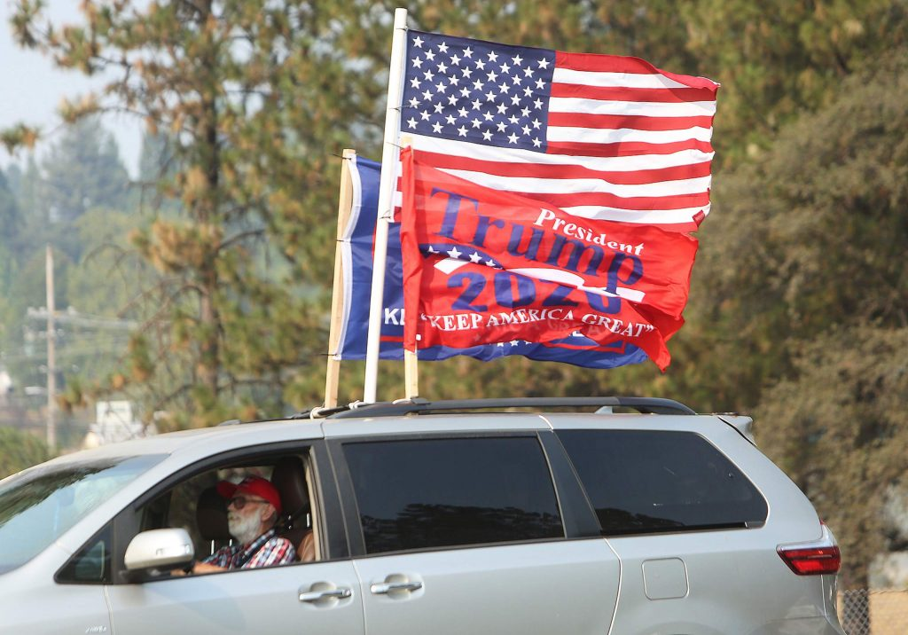 Folks let their Trump 2020 flags fly Saturday as they approached the car rally at K-Mart.