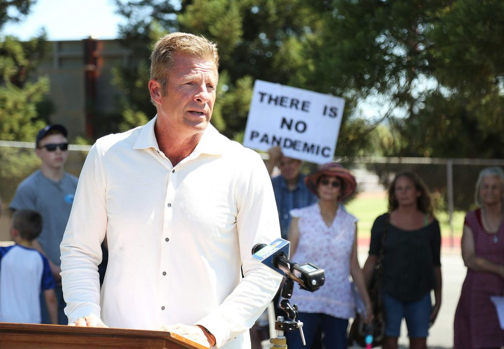 Local firebrand Eric Christen leads a Protect Nevada County Students press conference at Bear River High School on July 30, when a group of students, including Christen's daughter Sophia, formally withdrew from the school due to distance learning policies adopted by the district.