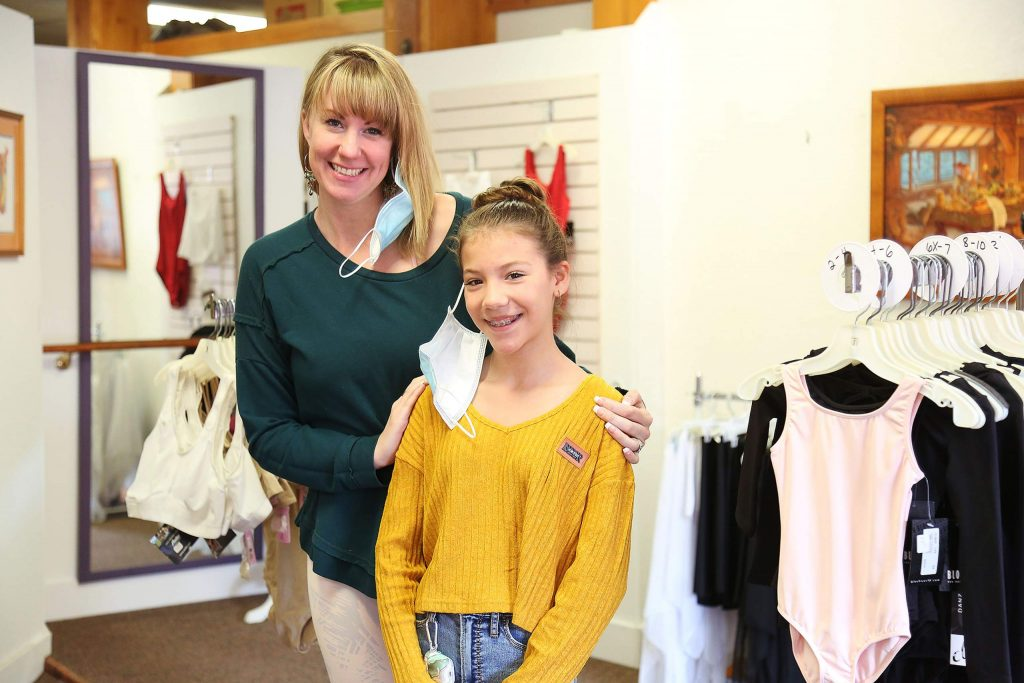Sierra Burton and 12-year-old daughter Devan Burton stand inside of the new dance and ballet apparel store, which is inside their art frame and photo restoration gallery at 124 E. Main St., Grass Valley.