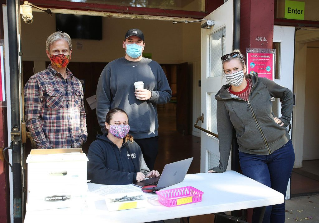 Bright Futures board member Cliff Brown, from left, site coordinator Cori Ove, Nevada County probation group supervisor Bryan Peterson, and site coordinator Evan Nielsen are some of those helping to make the new Distance Learning Center at the fairgrounds come to fruition.