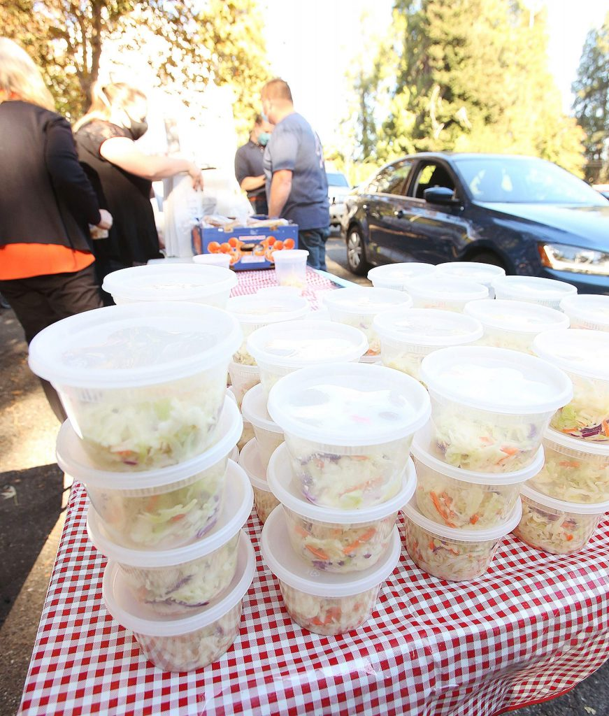 Stacks of cole slaw await to join the pulled pork sandwich meals, which also included beans, mac 'n cheese and a cookie.