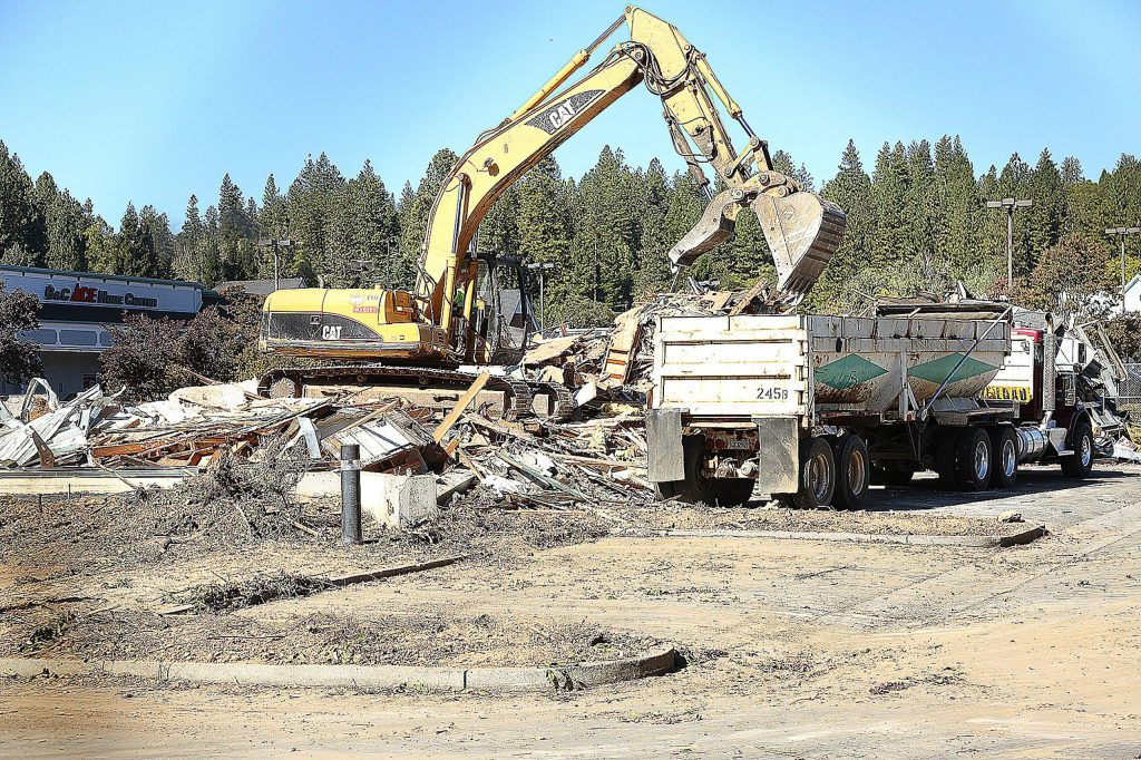 A Hansen Bros. crew works on clearing the site along Nevada City Highway for Grass Valley's new Dutch Bros. The site has been vacant for years, previously housing Ruby's Fine Gifts until 2008. The building which was once Ruby's was demolished Tuesday.