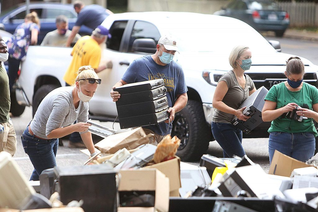 Mount St. Mary's Academy volunteers help to organize the massive amount of donated electronic items during the annual recycle event Saturday.