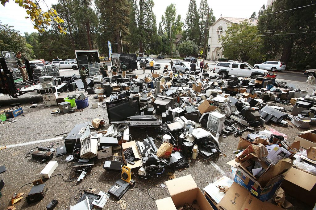 Used and broken electronics fill up a portion of the Mount St. Mary's Academy parking lot during Saturday's e-waste recycling event.
