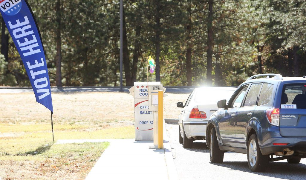 A steady flow of vehicles makes its way into the Eric Rood Administrative Center parking lot in Nevada City this week, where an official Nevada County ballot drop box is located.