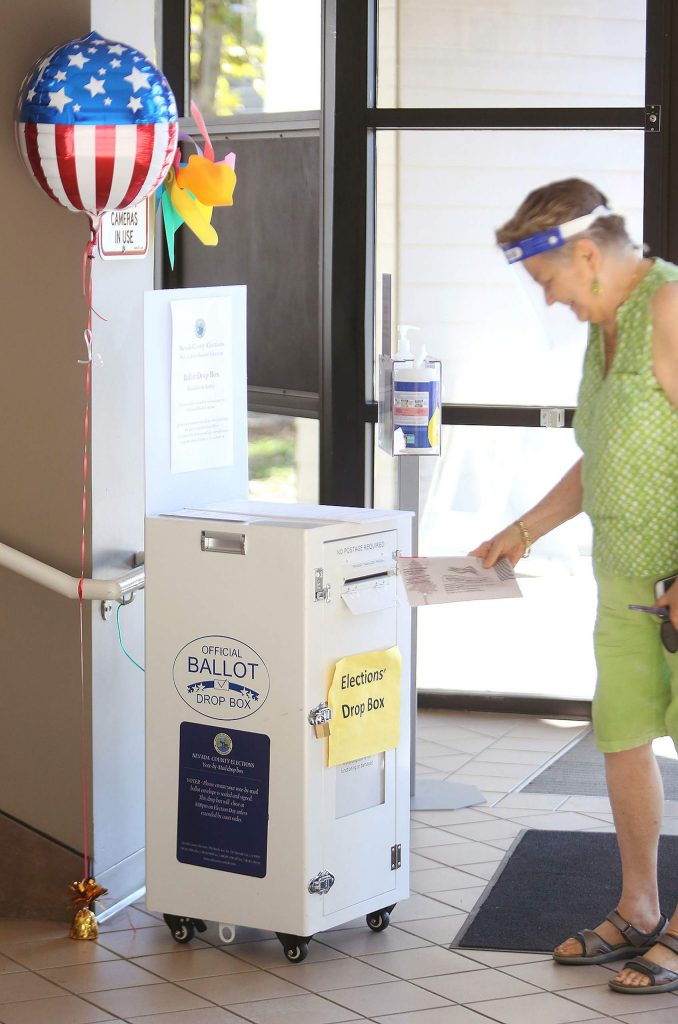 Nevada County's Marilyn Nyborg drops off her ballot Friday at the Eric Rood Administrative Center in Nevada City.