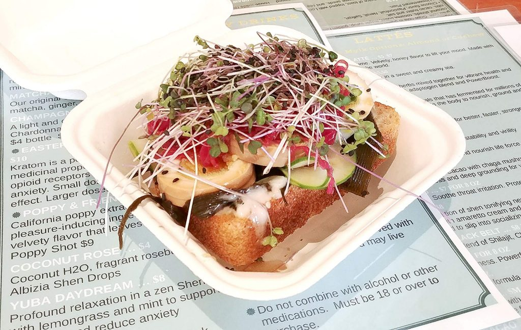 Elixart's Tomago Toast, featuring sliced egg atop Mendo seaweed salad, local sprouts, and Local Culture sauerkraut, is ready for a customer in downtown Grass Valley.