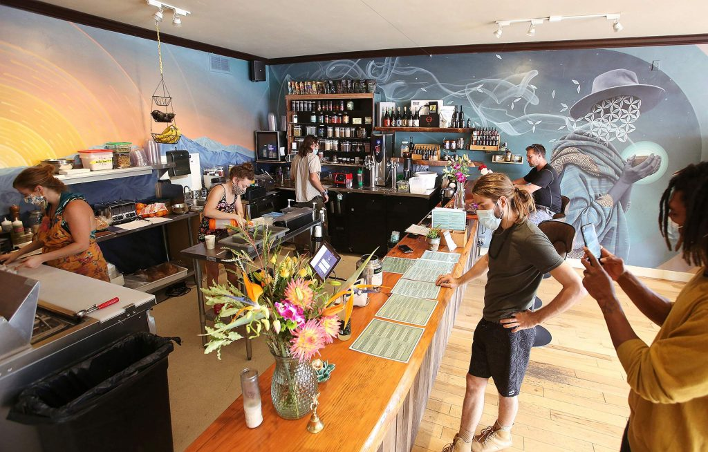 Elixart's new location in downtown Grass Valley is now open near the intersection of Main and South Auburn streets. This shop features healthy bites to eat, as well as interior wall murals painted by muralist Miles Toland.