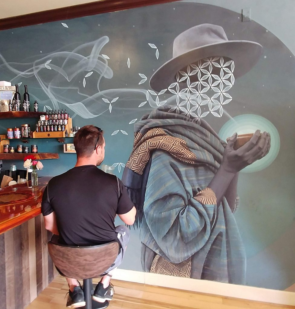 A customer last week takes in one of the Miles Toland murals painted inside the new Grass Valley Elixart.