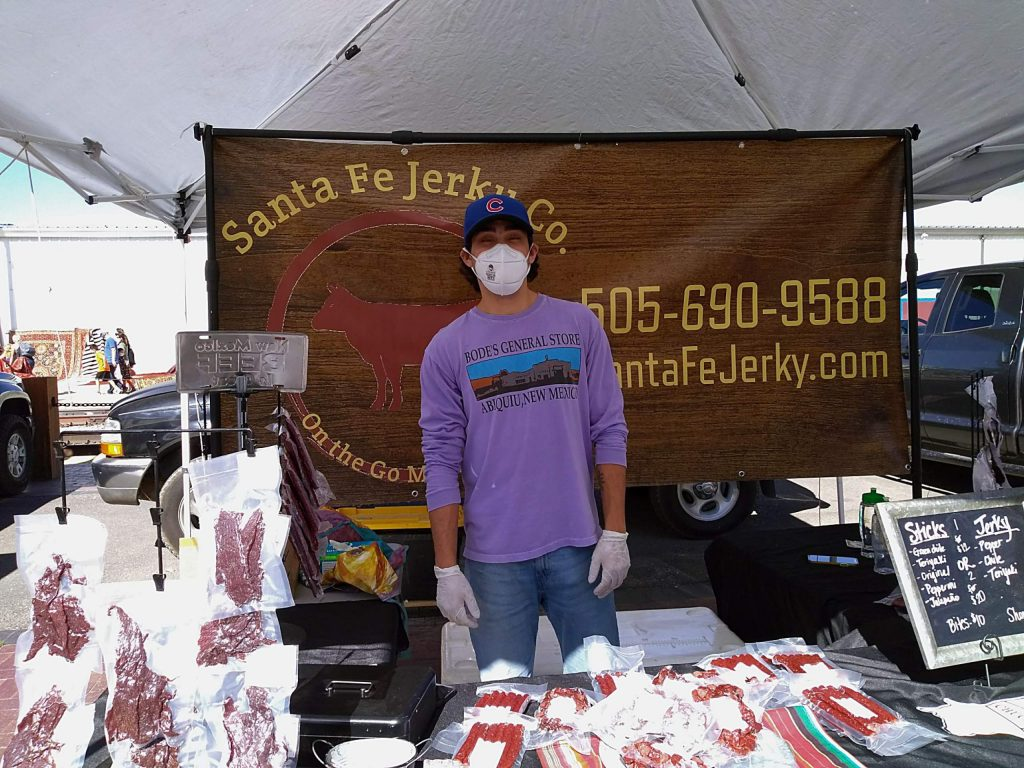 Matt Oakeley of the Santa Fe Beef Jerky Company. Walking into the Santa Fe Farmers Market, you can quickly see the subtle and not so subtle differences from our Nevada County markets. For one thing, there are over 150 vendors on any given Saturday. They come from various small towns throughout the northern counties of New Mexico selling everything from buffalo meats to desert honeys, herbal remedies, seeds, flowers, pecans, pomegranates and of course, beans, corn and chilis.