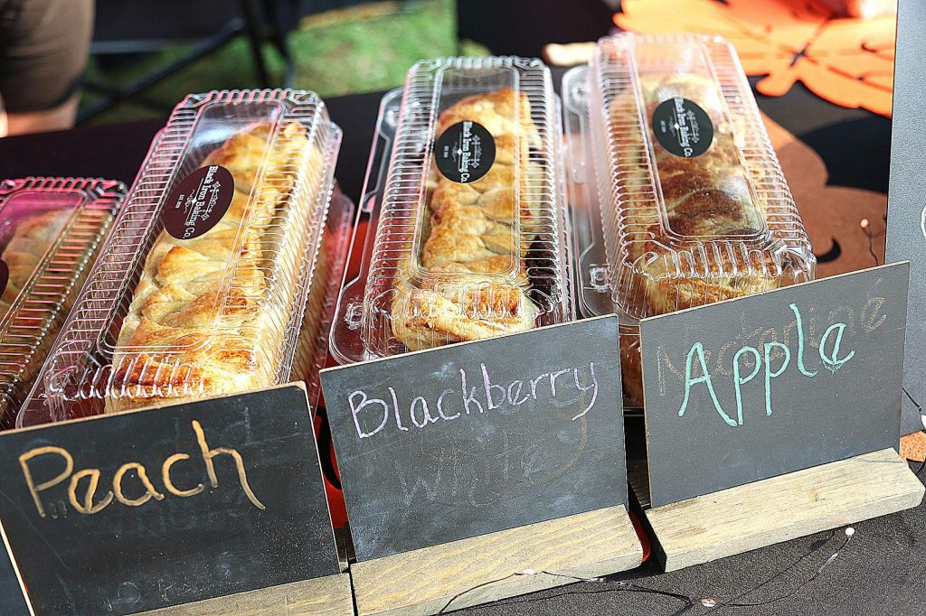 Delightfully baked and perfectly packaged treats from Black Iron Baking Co. of Penn Valley are offered for sale Thursday morning at the Western Gateway Park farmers' market in Penn Valley.