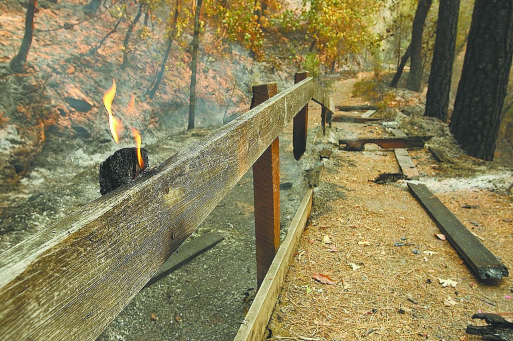 Flames continue to burn portions of the Independence Trail's structures Wednesday outside of Nevada City.