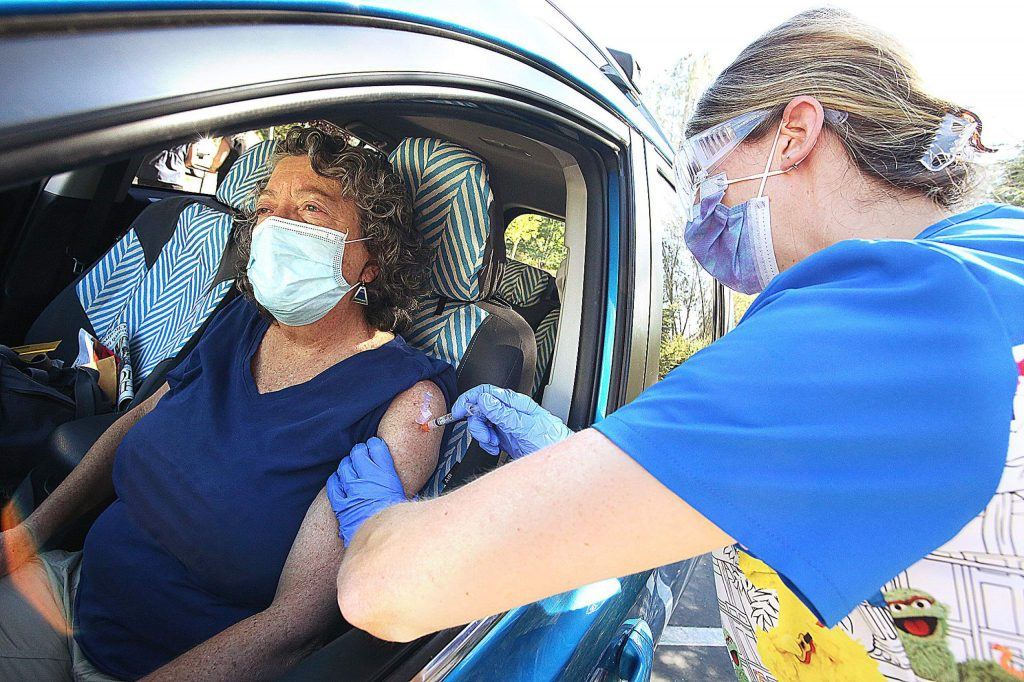 Nevada City's Diane Cross gets her free drive-thru flu shot with the help of nurse Elise Zink Tuesday at Chapa-De Indian Health clinic in Grass Valley. The clinic will continue to give out free flu shots  from 1:30 to 5:30 p.m. on Tuesday, Oct. 27.