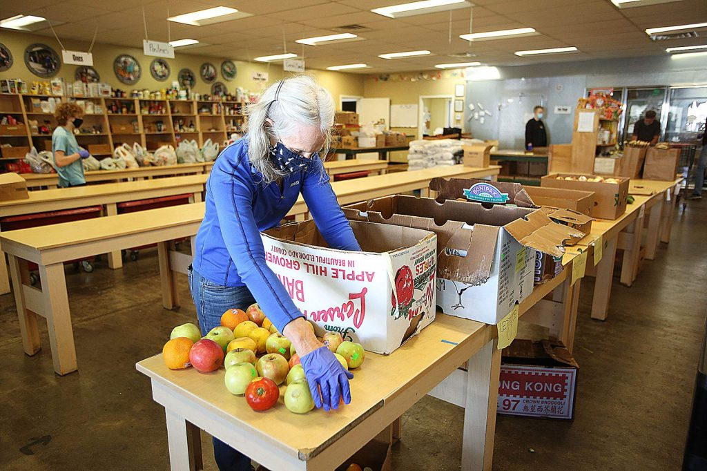 United Way volunteer Fran Haulman helps sort apples to be given away with food supplies for families.