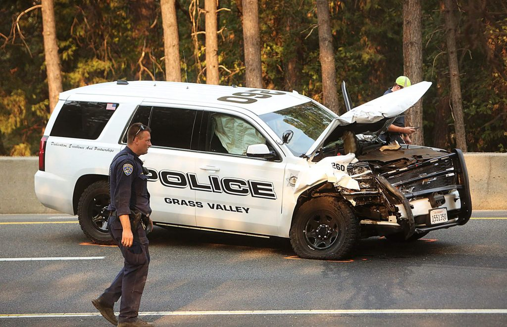 CHP officers conduct their investigation into Thursday's head-on vehicle collision on Highway 49 involving Grass Valley police officer John Herrera and Patrick Grady. Grady was driving a stolen vehicle. Herrera was taken to Sierra Nevada Memorial Hospital, but was not seriously injured.