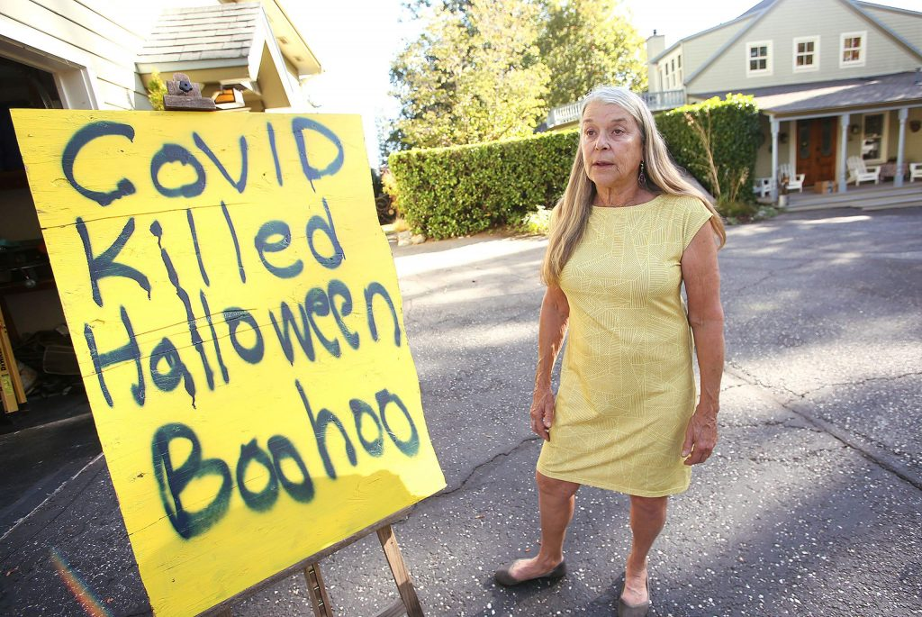 """By this time each year, former Nevada City Mayor Evans Phelps' Pine Street home is usually adorned with every different kind of ghost, ghoul, and goblin decoration imaginable. This year, Phelps' yard will sit vacant and dark, with only a sign stating """"COVID killed Halloween Boohoo"""" in front of her house."""