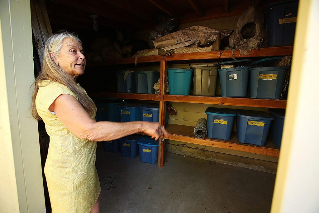 Nevada City's Evans Phelps shows off where her hundreds of Halloween decorations are stored. She has chosen not to host her renowned haunted house due to COVID-19.
