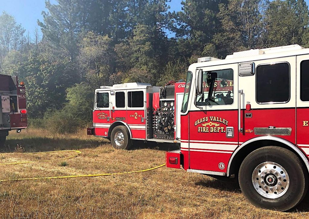 Grass Valley firefighters responded to a vegetation fire off Brunswick Road Sunday afternoon, containing the blaze to 2 acres.