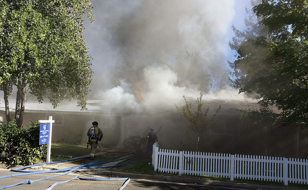 Two structures on fire Sunday afternoon on Forest Glade Circle, Grass Valley.