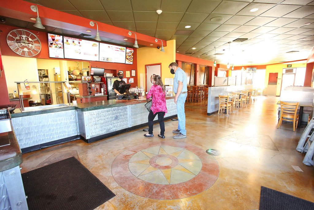 Customers order inside of Jimboy's Tacos off Nevada City Highway in Grass Valley Thursday. The restaurant's drive-thru and dining room is open for business once again.