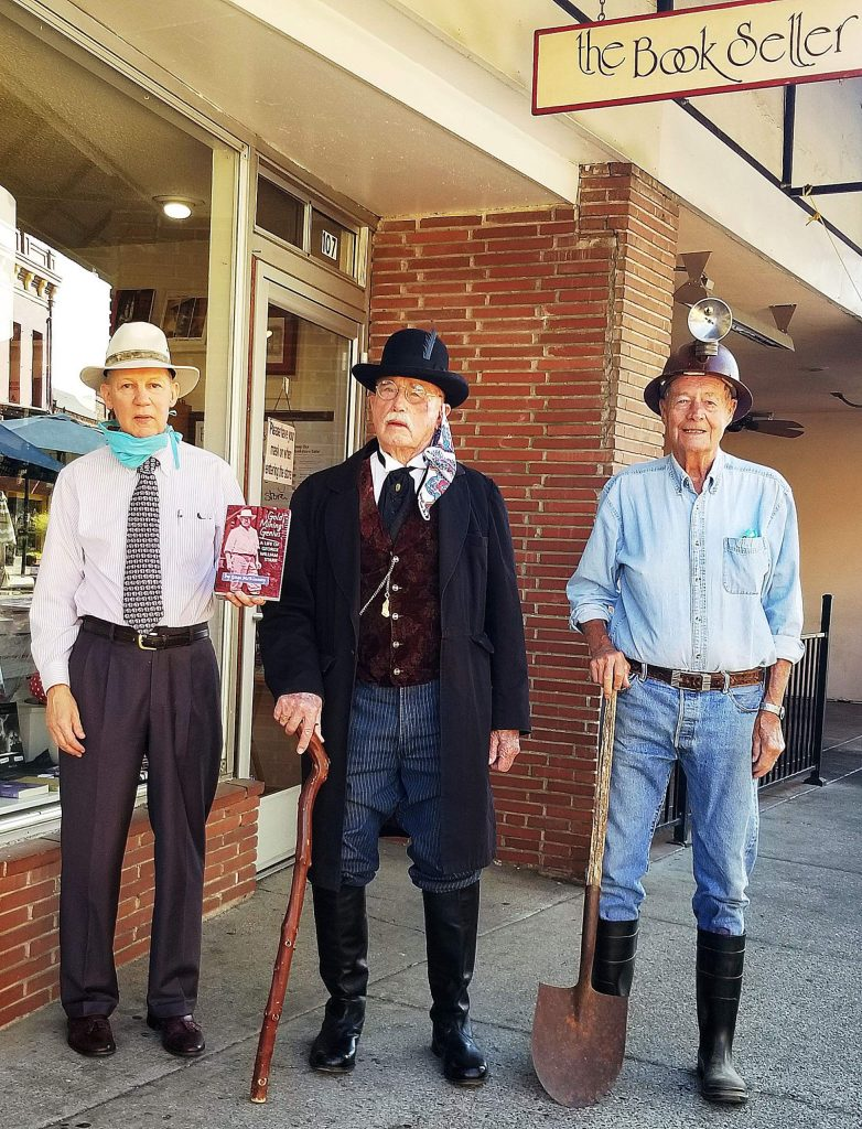 "Gage McKinney, left, wrote ""Gold Mining Genius: A Life of George Starr,"" available at The Book Seller and Harmony Books. The book is dedicated to Vince Seck, center, who dresses in period costumes and portrays George Starr at Empire Mine State Park events. Orlo Steele, right, is one of the few remaining locals who worked in the Empire Gold Mine during the 1950's."