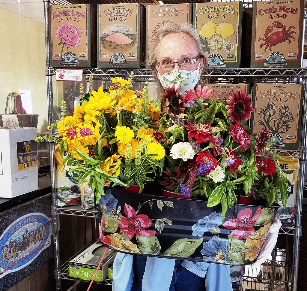 At Rare Earth Landscape Materials, Kim Pedley sells large, colorful flower bouquets for only $8. Pedley creates the bouquets from flowers and herbs she grows on a one-acre plot.