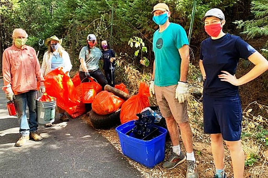 These members of the Wolf Creek Community Alliance and Bear Yuba Land Trust, whose identities remain unknown behind their masks, joined forces to remove several hundred pounds of garbage along Wolf Creek during the 23rd Annual South Yuba River Cleanup.