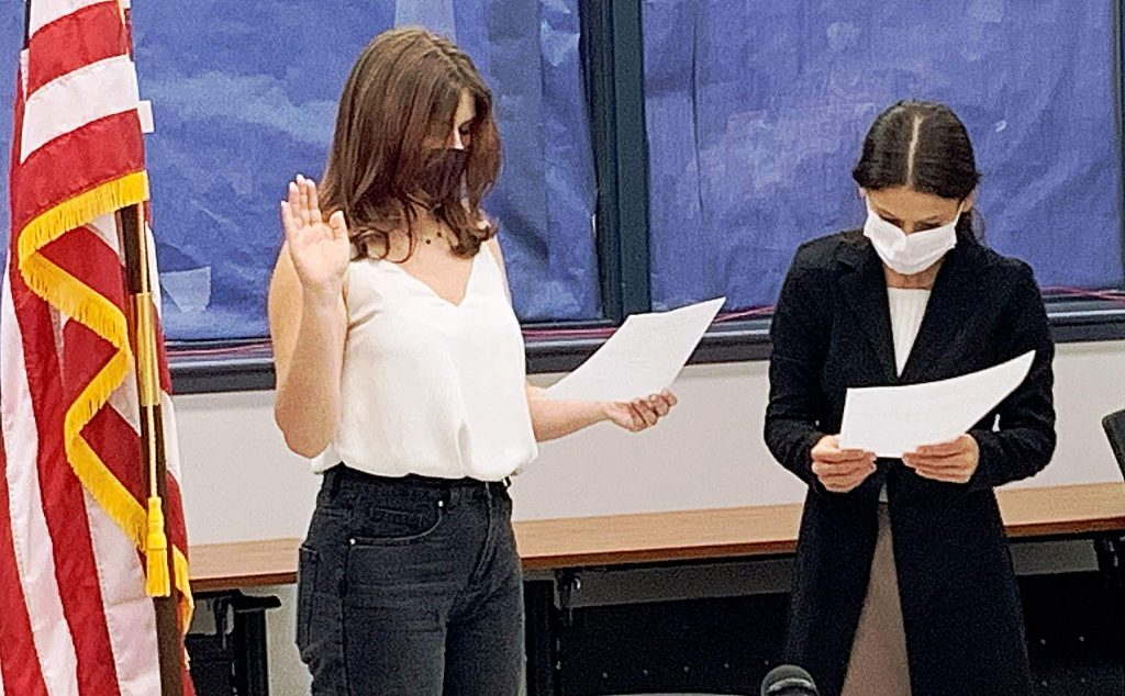 Sabine Noyes, left, a junior at Nevada Union High School, who is this year's student representative to the Nevada Joint Union High School District Board of Trustees, was sworn in last week by outgoing student board member Maggie Aguilar-Diaz.